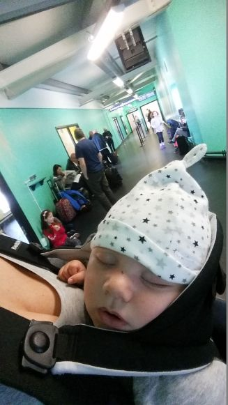 5 minutes in the baby bjorn at Stansted airport, and hes asleep :)